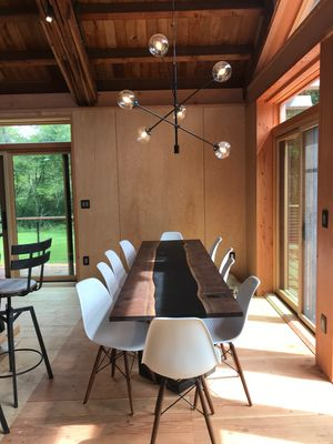 Dinning room table with seating for 10.  (w/ black walnut river table).