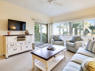 Photo for Quiet, professionally decorated, 1st floor beachfront getaway, 70 steps to beach