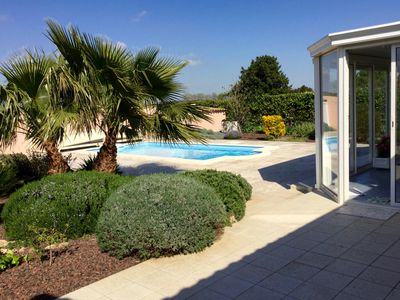 Photo for In a charming village, nice villa with pool, air-conditioned bungalow