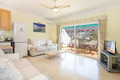 Big lounge. Spacious terrace with outside dining table. Views to valley & port