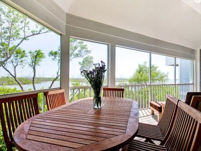 Large porch with views of Clam Bayou and Gulf