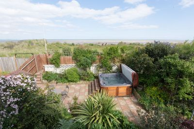 view from balcony of private , secluded garden with hot tub