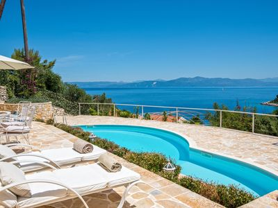 Photo for Splendid stone villa hovering above bay and sea views,with private pool
