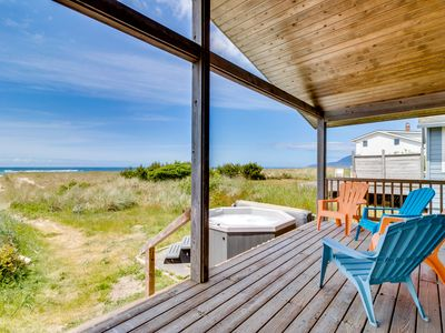 Photo for Dog-friendly, oceanfront beach cottage w/ private hot tub! Right on the beach!