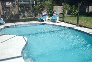 Large ( 30' x 15') sunny pool surrounded by extensive decking