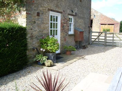 The private sunny courtyard welcomes guests to Close House Cottage
