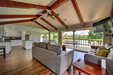 Wall-to-wall windows open to fantastic views at this vacation rental house.
