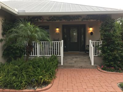 Photo for Charming and cozy pool home on canal and near attractions