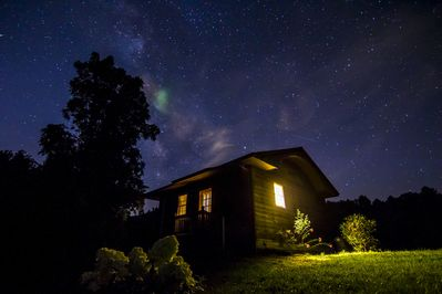 Night time sky over cottage one summer night