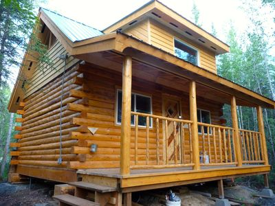 Forest Cabin - an alaskan log cabin nestled in a forest setting.