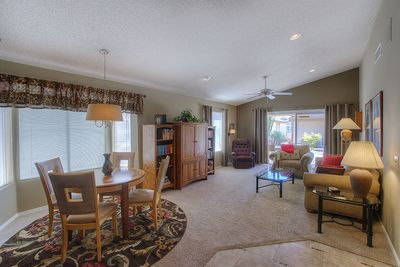 Spacious living and dining area with patio access