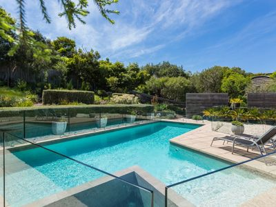 Photo for Stunning ocean side living with sparkling pool