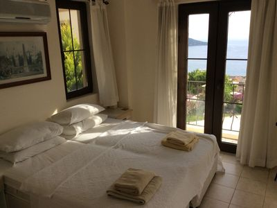 Photo for 2 bed self contained furnished flat with pool, 5 mins from town and beach