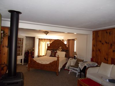 Photo for Wendy's cottages, ( Kozy Kove ), on river, fishing, private deck & hot tub. 2 Br