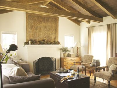 Original 1920s beams, fireplace & wood floors. French country antiques & charm.