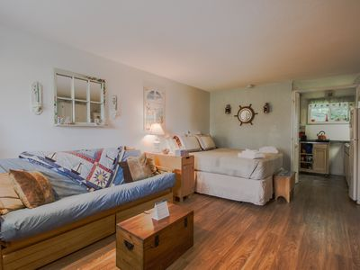 Photo for Cozy condo w/ shared swimming pool & deck space - walk to Footbridge Beach!