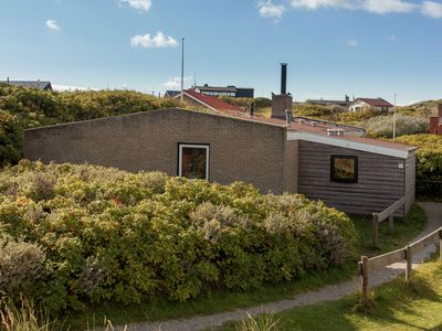 Photo for Detached bungalow in the Vlieland dunes, near the beach entrance.