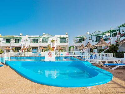 Photo for Charming Apartment Los Pocillos Close to Beach with Pool, Terrace, Balcony, Ocean View & Wi-Fi