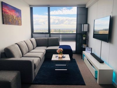 "Lounge room with Sofa bed, 55"" Smart TV & Home Entertainment System"