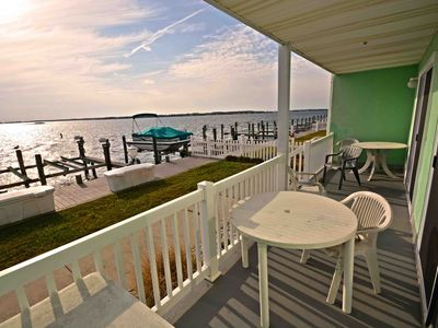 Photo for Bright, colorful 2 bedroom condo with free WiFi and a gorgeous view of the harbor located downtown on the bay water just three blocks from the beach and boardwalk!