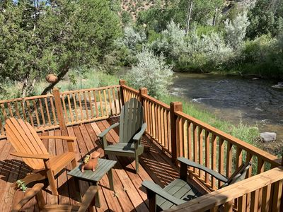 Relaxing deck overlooking the Embudo River  with seating for four