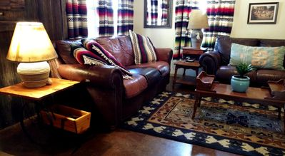 Spacious and comfortably furnished living room in the Agave Log Cabin at New Mexico Cabin Rentals.
