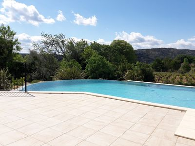 Photo for Ground floor apartment with beautiful terrace, infinity pool with view