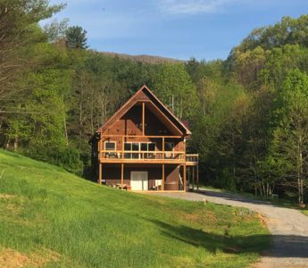 Photo for Peach Bottom Lodge NEW - 3 Bedroom, 3.5 Bath, 11.5 Acres, Deck w/ Hot Tub & More