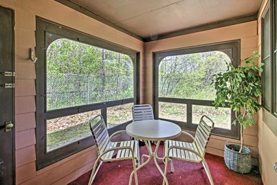 Sip your morning coffee in this vacation rental's screened-in patio.