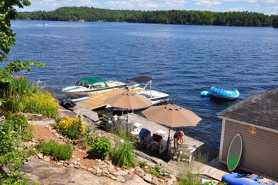 large deck area with chairs and umbrellas.  Great swimming area