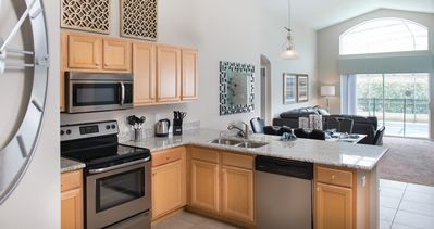 The kitchen is a large space with new major appliances and granite counter tops.
