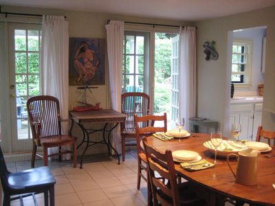 Spacious Dining Room with French Doors to Exclusive Deck