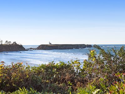 Photo for Dog-friendly, oceanfront rental w/ patio, incredible lighthouse & ocean views