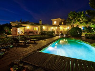 Photo for Large 6 bedroom villa with heated pool and sea view. Walking distance of beach