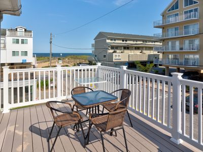Photo for Cozy seaside escape with ocean view from balcony - just 30 ft. from the beach!