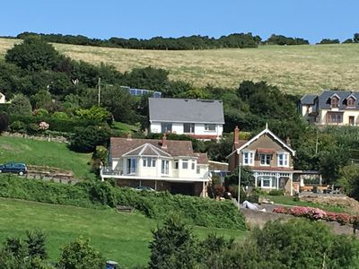Photo for Modern 3 Bedroom Bungalow with Fantastic Views Over the Bay of Combe Martin