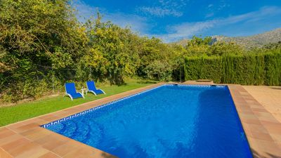 Photo for Beautiful white villa with pool surrounded by olive trees
