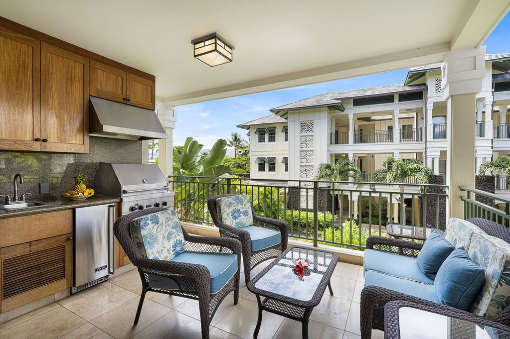Lanai with outdoor kitchen and chairs