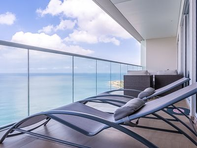 Photo for Oceanfront apartment w/ stunning sea view from balcony, shared pool & hot tub
