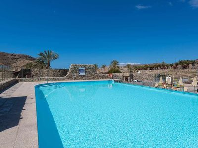 Photo for Great duplex with pool near the beach