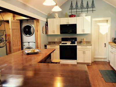 New Kitchen: Washer Dryer, Microwave, Stove (white door is full bath)