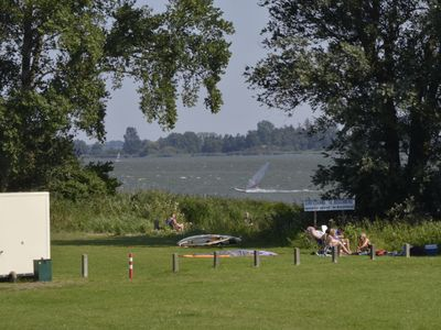 Photo for Spacious modern bungalow, lots of greenery, on border lake and 1.5 km from Walibi World.
