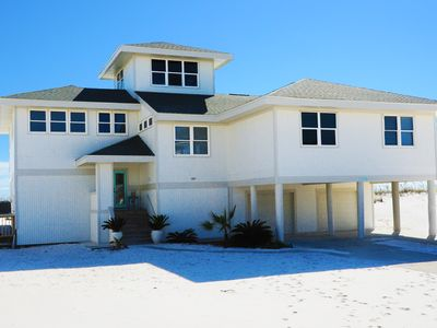 Photo for Family-friendly. Large Gulf side deck is great for sunsets and entertaining!