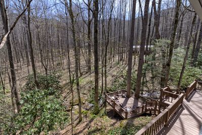 View of lower deck and woods across the creek