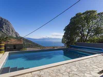 Photo for RECOMMENDATION! Holiday house with heated pool, large terrace with sea views, barbecue