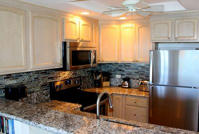 Newly Remodeled Kitchen with Stainless Steel Appliances & Granite Countertops