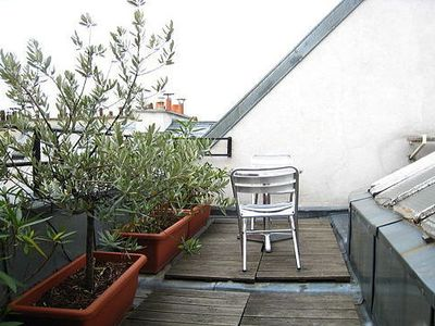 Photo for Newly refurbished flat with a terrace in the heart of Paris