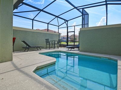 Photo for BEAUTIFUL PROFESSIONALLY DECORATED WITH 2 MASTER SUITES, SOUTH FACING POOL, FREE WIFI!