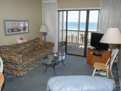 Photo for JUNE DEALS!  OCEANFRONT 2 Bedroom 2 Bath WIFI, Outdoor Pool, W/D and Grilling area