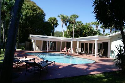 Free Form Pool & Patio Deck with plenty of covered & open areas.